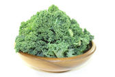 Kale in a wood bowl — Stock Photo