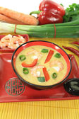 Curry soup with shrimp and bell pepper — Stock Photo