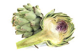 Sliced and whole artichokes — Stock Photo