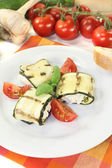 Fresh delicious stuffed courgette rolls — Stock Photo