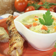 Chicken soup with tomatoes — Stock Photo