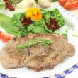 Sirloin steak with wild herb salad — Stock Photo