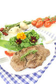 Fresh Sirloin steak with wild herb salad — Stock Photo