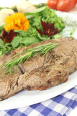 Sirloin steak with wild herb salad and rosemary — Stock Photo