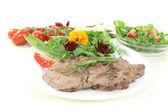 Fried Sirloin steak with wild herb salad — Stock Photo