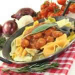 Pasta with sausage stew — Stock Photo #22317843