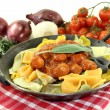 Pasta with sausage stew - Stock Photo