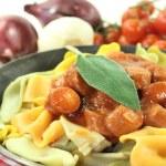 Pasta with sausage stew — Stock Photo #22318043