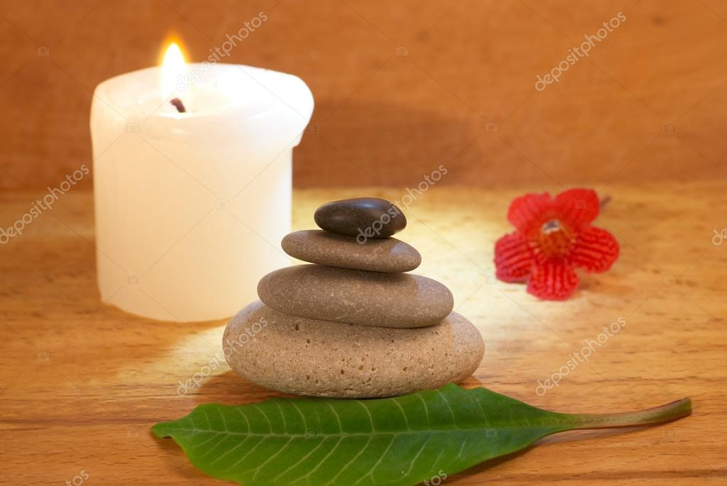 Spa concept with candle zen stones and wooden background — Stock Photo #16493843