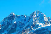 High mountains, covered by snow. — Stock Photo