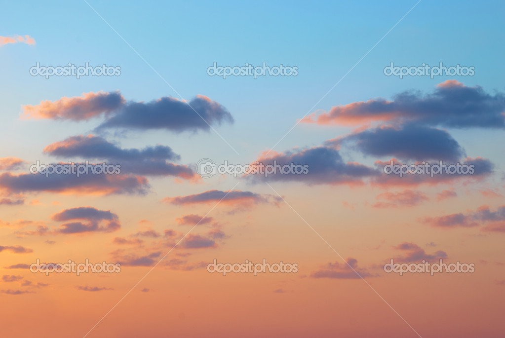 Romantic sunset with beautiful blue, red and yellow clouds. — Stock Photo #19465795