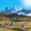 Campsite with tents on the top of high mountains — Stock Photo