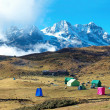 Campsite with tents on the top of high mountains — Stock Photo #22890398