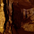 Inside the beautiful cave. Underground world opened with light brush technique - Stock Photo