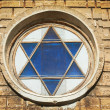 Blue star of David in the window — Stock Photo