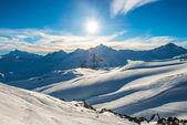 Snowy blue mountains in clouds — Stock Photo
