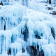 Frozen waterfall of blue icicles — Stock Photo #49928759