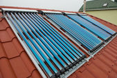 Vacuum collectors- solar water heating system — 图库照片