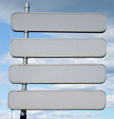 Signpost with 4 blank signs spaces — Stock Photo