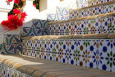 Traditional arabic architecture surrounding exotic plants — Stock Photo
