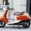 Stock Photo: Orange motobike in street of Old Tbilisi
