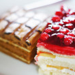 Closeup of sweets on a white plate — Stock Photo