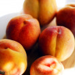 Closeup of ripe juicy peaches — Stock Photo
