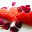 Red hearts and rose petals on the white background — Stock Photo #13378344