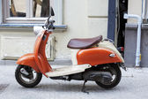 Orange motobike in the street of Old Tbilisi — Stock Photo