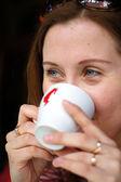 Nice blond woman drinking coffee — Stockfoto