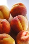Closeup of ripe juicy peaches — Stock Photo