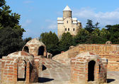 One of the old Tbilisi symbol - Metekhi church and domes of anci — Stock Photo