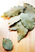 Closeup of bay leaves on the wooden desk — Stock Photo