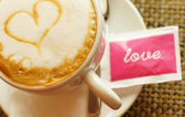 Cup of cappuccino with heart — Stock Photo