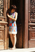 Woman and old door — Stock Photo