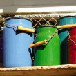 Color watering cans — Stock Photo
