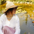 Woman at a pond with lilies — Stock Photo