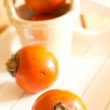 Ripe persimmons — Stock Photo