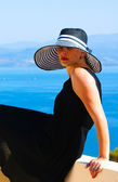 Portrait of woman in a straw hat — Stock Photo