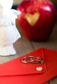 Red envelope and white heart — Stock Photo