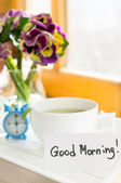 Mint tea, violas flowers and Good morning note — Stock Photo