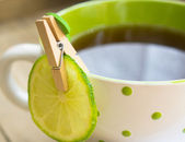 Tea and lime — Stock Photo