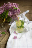 Lilac and mint tea — Stock Photo