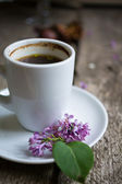 Lilac flower and coffee — Stock Photo