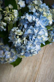 Hydrangea flowers on wooden table  — Stock Photo