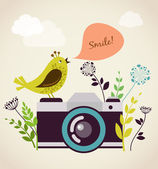 Old vintage camera with bird — Stock Vector