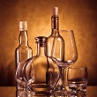 Whiskey, cognac and wine bottles with glasses — Stock Photo