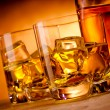 Two whiskeys and a bottle — Stock Photo