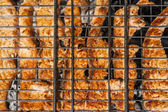Salmon fillet on the grill with flames in horizontal orientation — Stock Photo