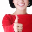 Beautiful young woman showing thumbs up sign — Stock Photo